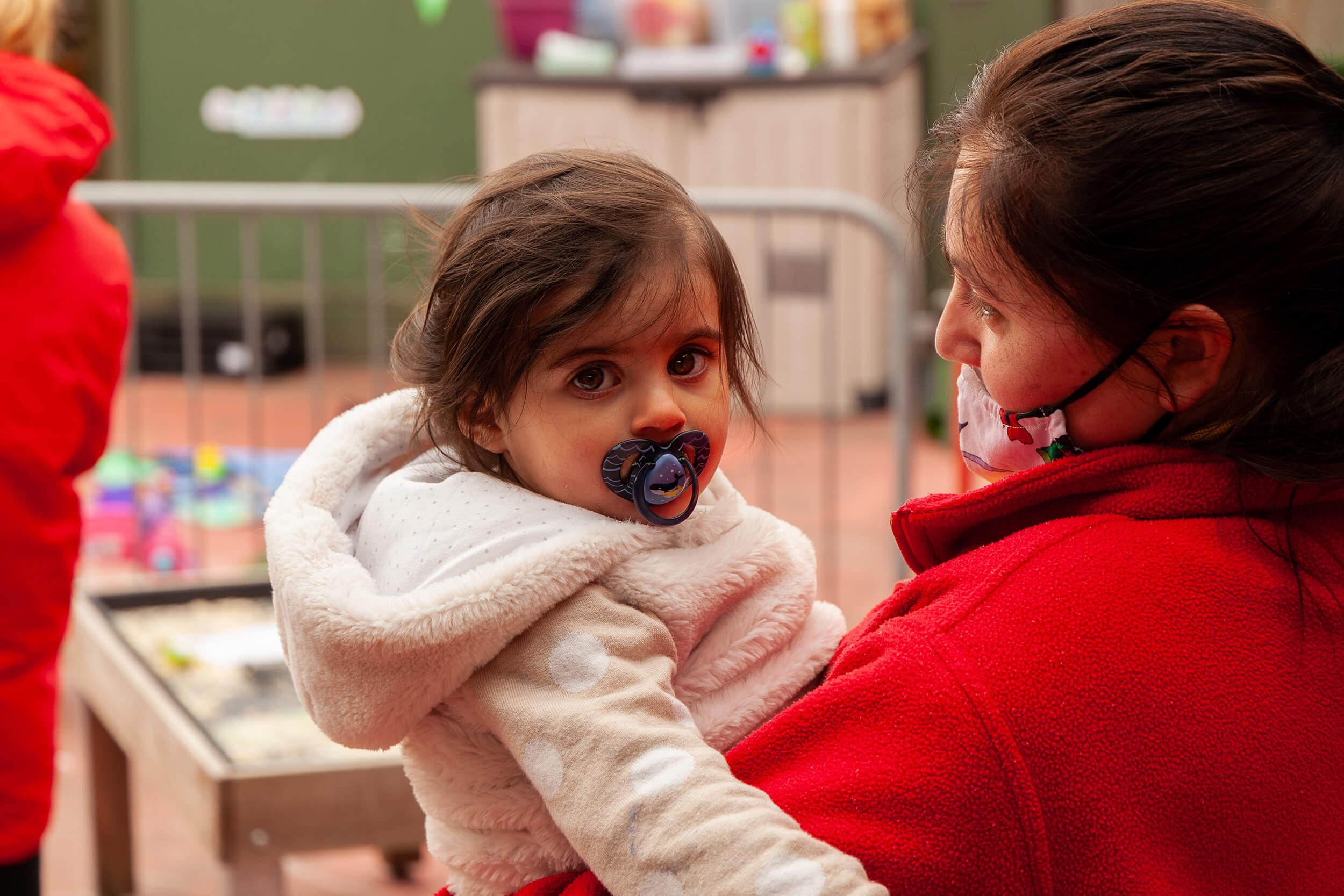 nursery nurse and girl with a dummy