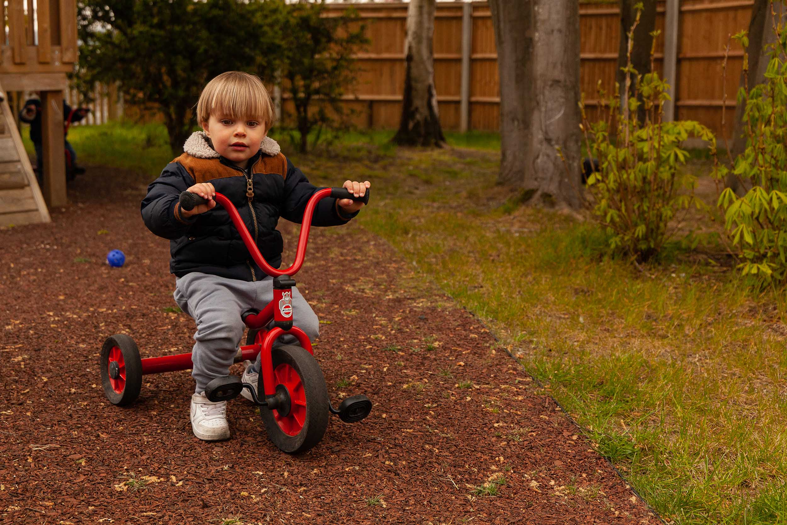Boy on a tricycle