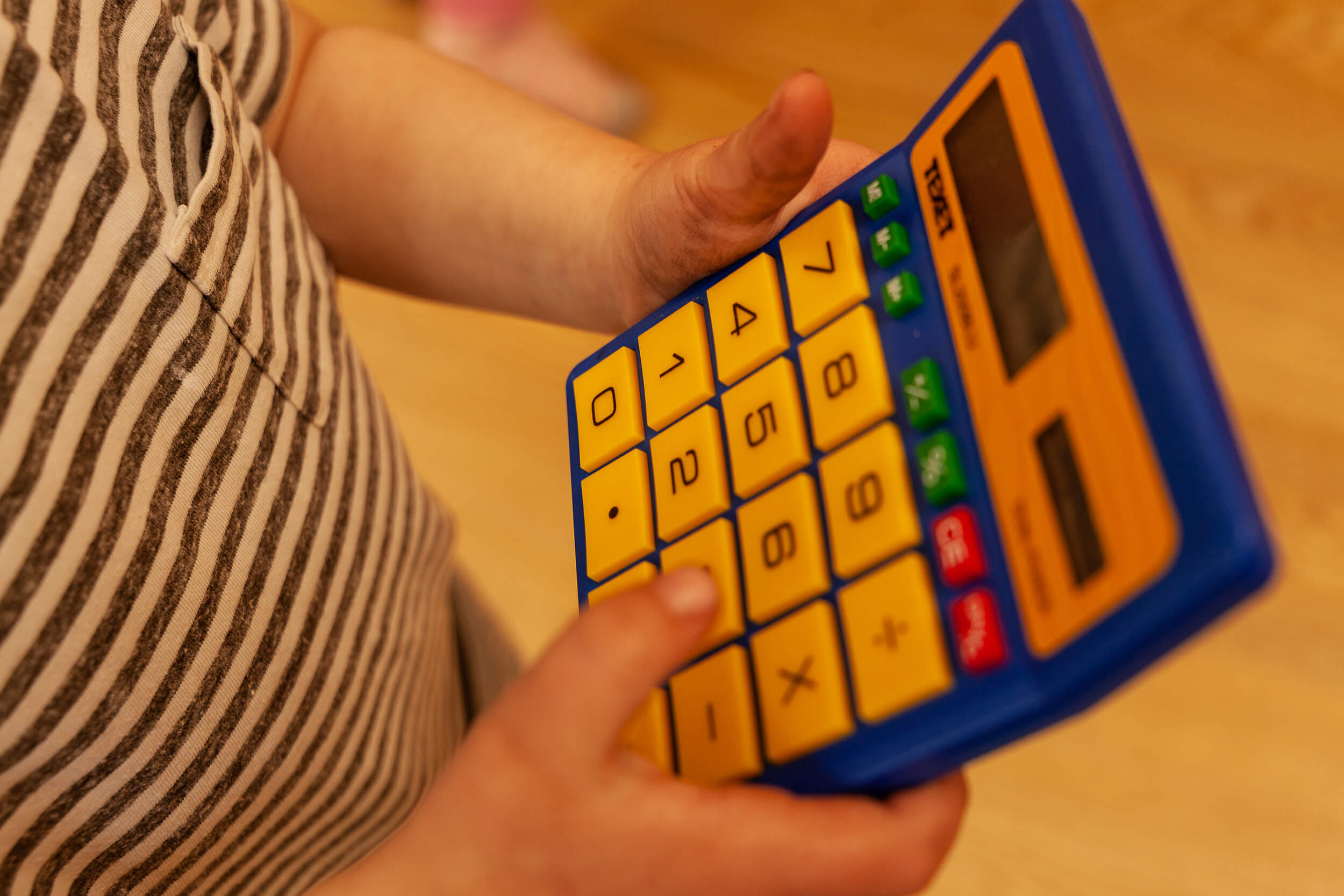 Boy playing with a calculator
