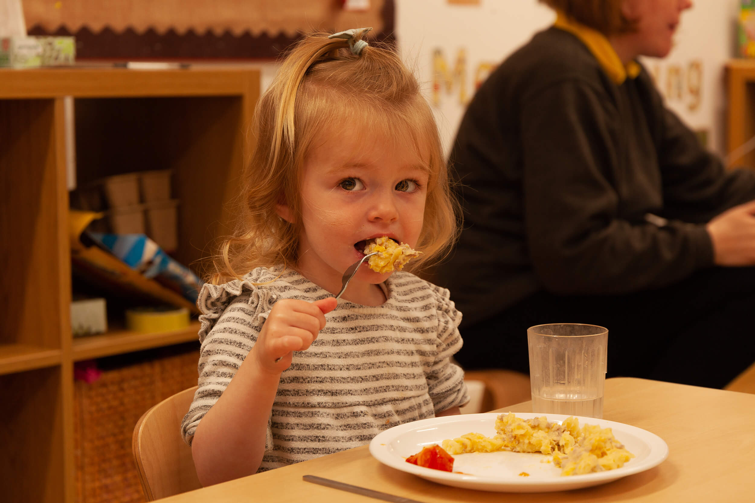 Girl eating at the table