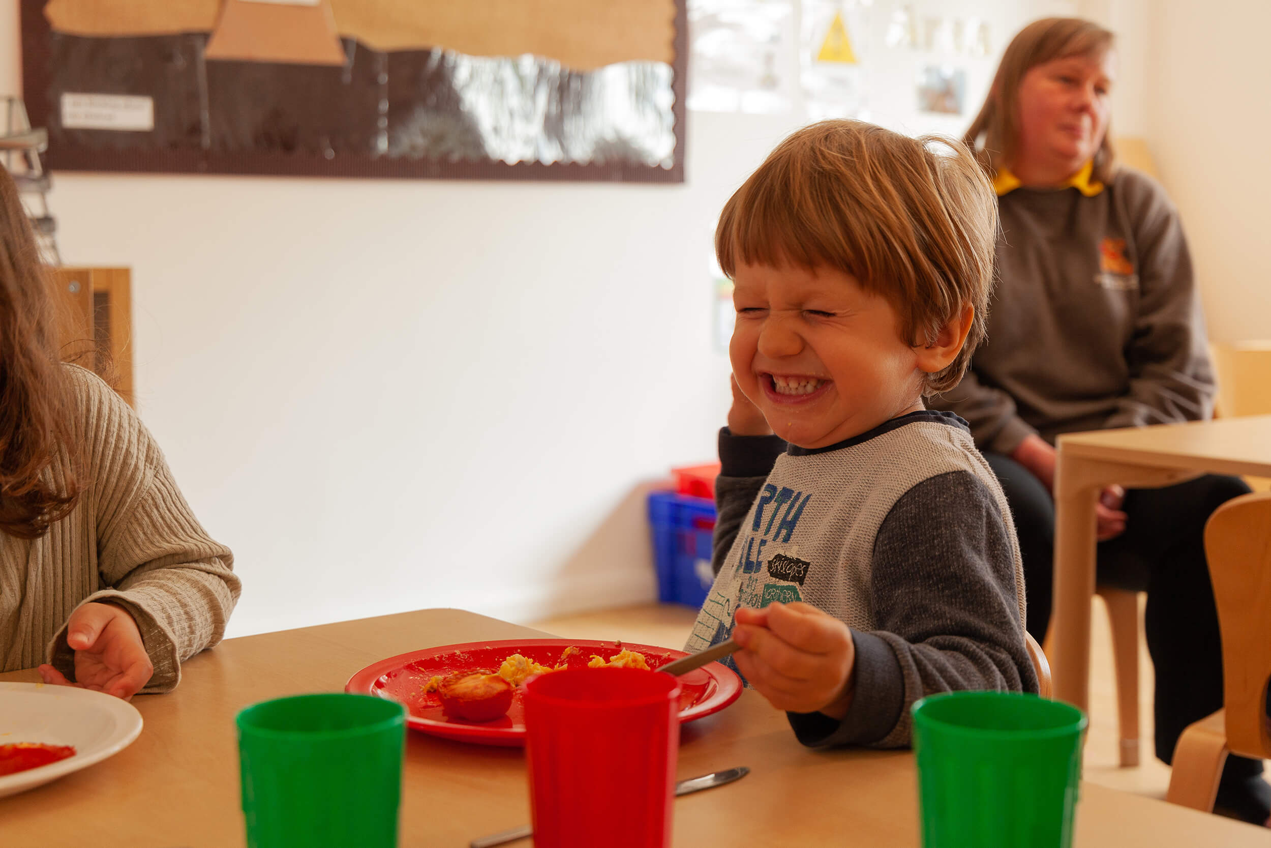Boy laughing at the table