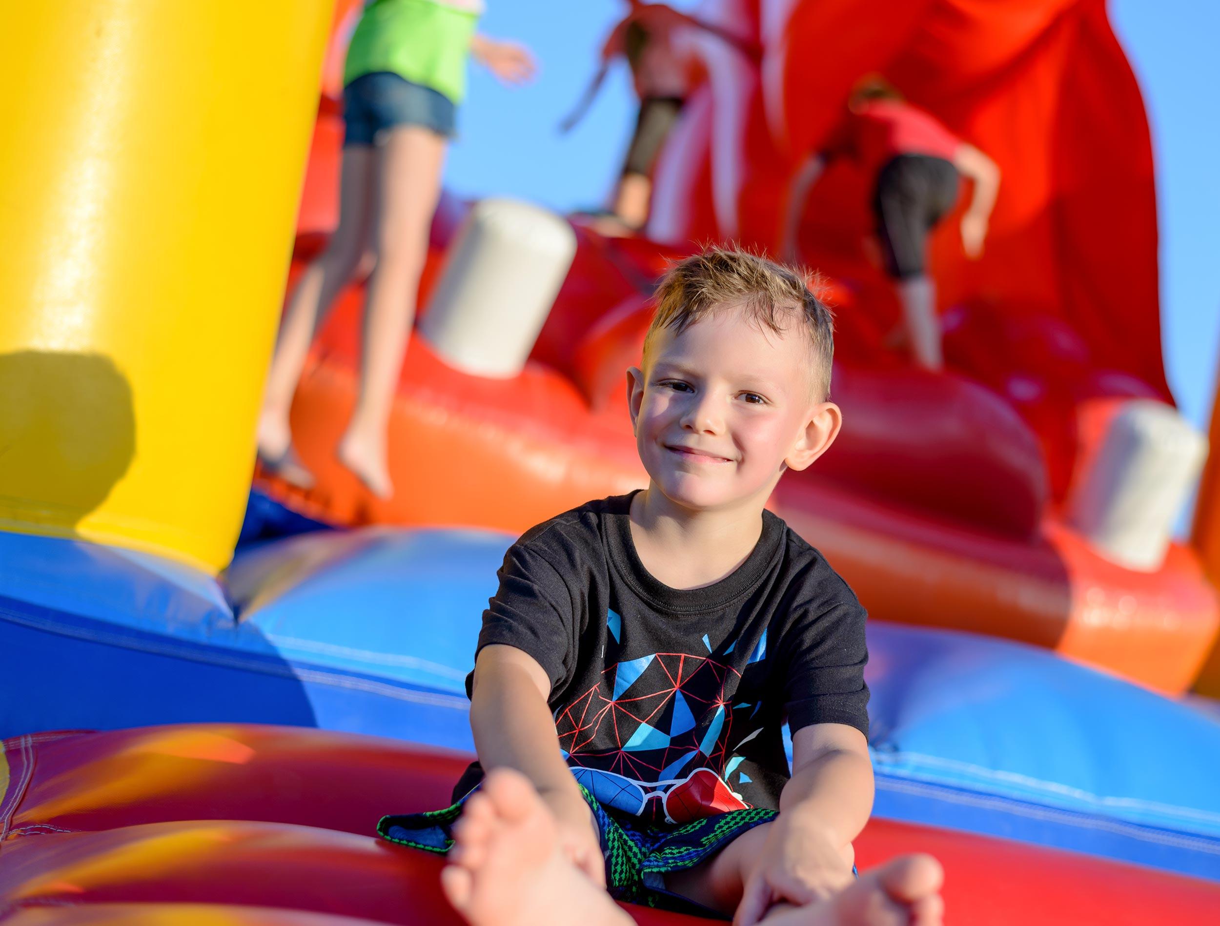 Boy on bouncy castle