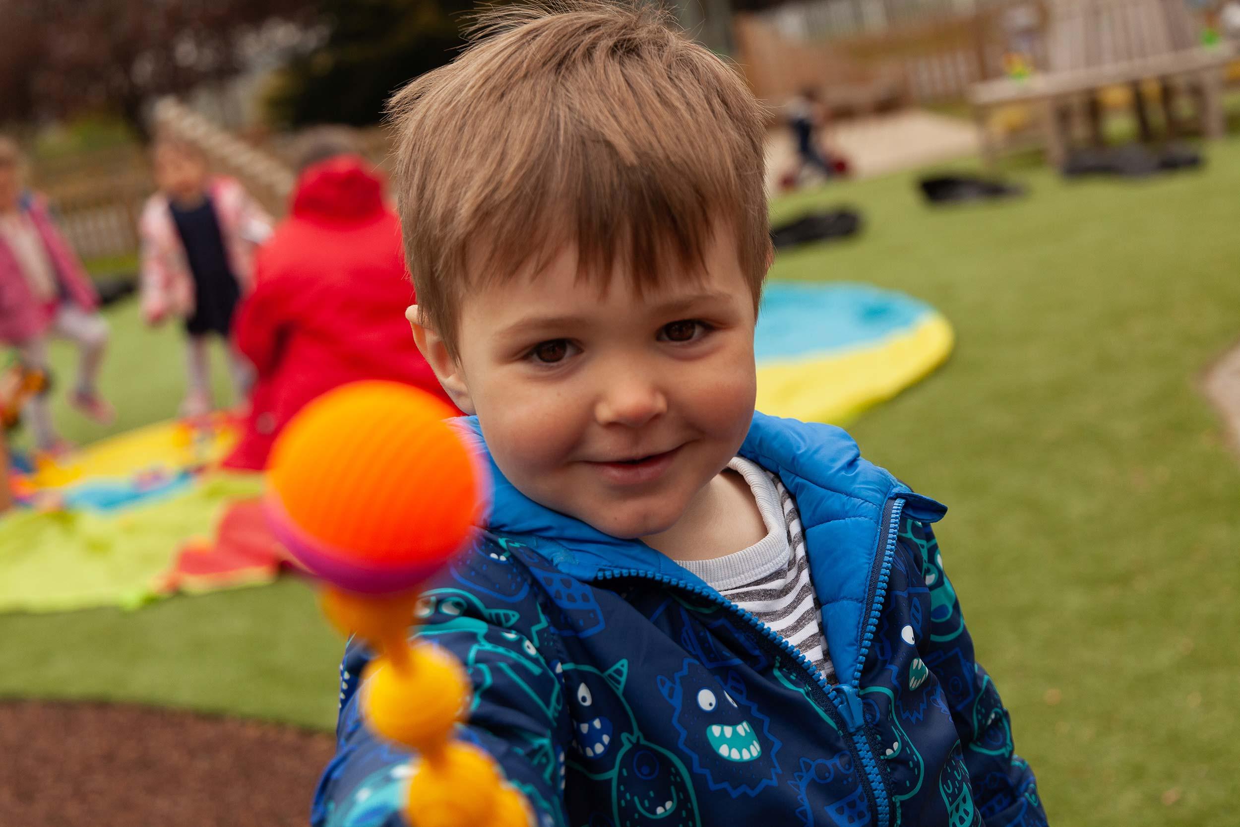 Boy with balls looking at camera