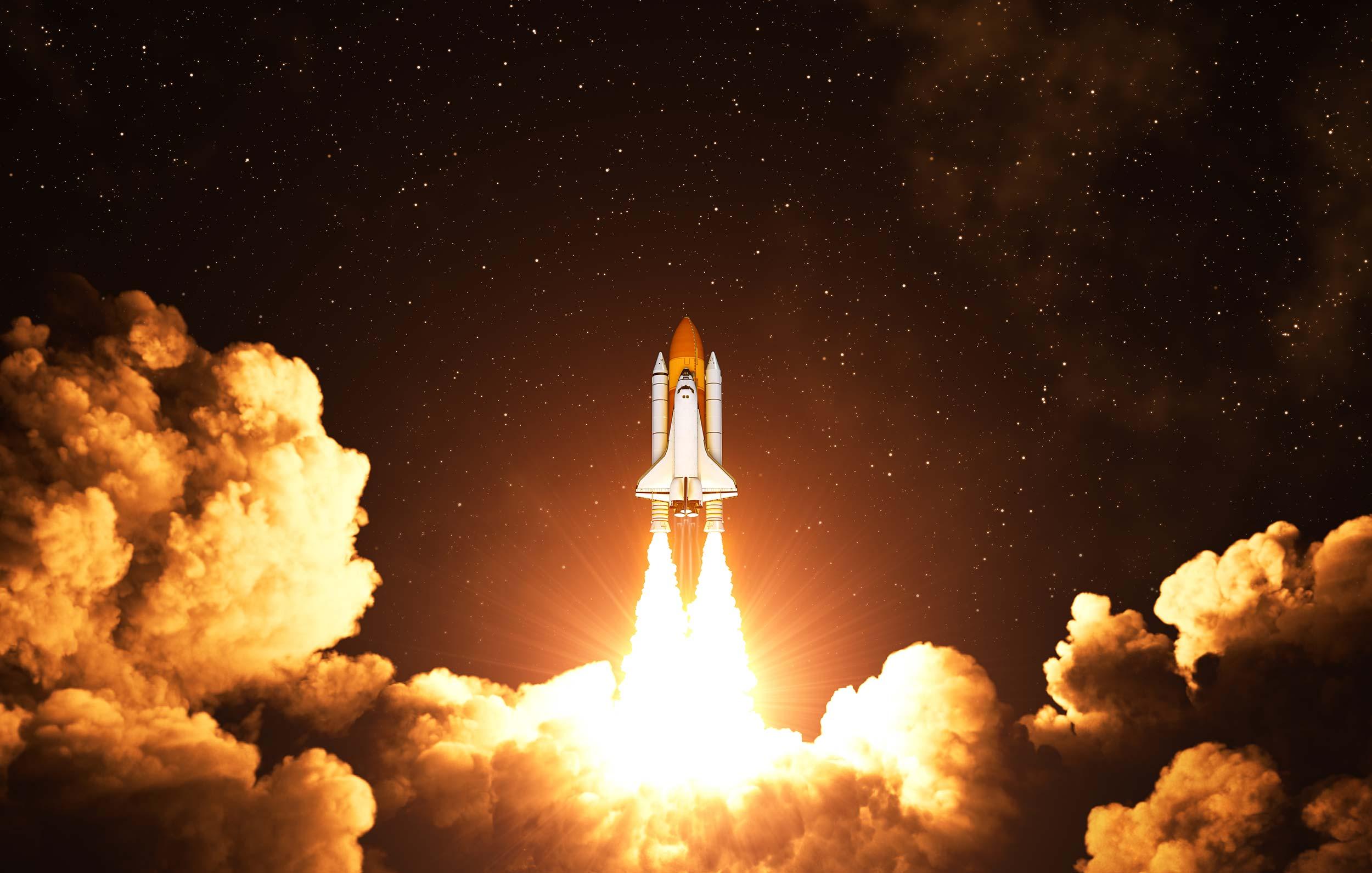 Rocket taking off at night